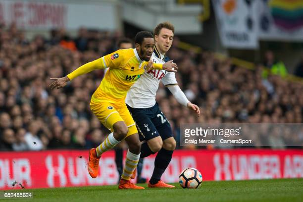 Millwall's Shaun Cummings holds off the challenge from Tottenham Hotspur's Christian Eriksen during the Emirates FA Cup Sixth Round match between...