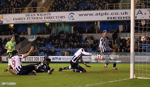 Millwall's Shaun Cummings scores his side's second goal of the game during the Emirates FA Cup Third Round match at The Den London