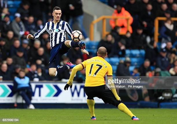 Millwall's Shaun Williams and Watford's Adlene Guedioura during the Emirates FA Cup Fourth Round match at The Den London