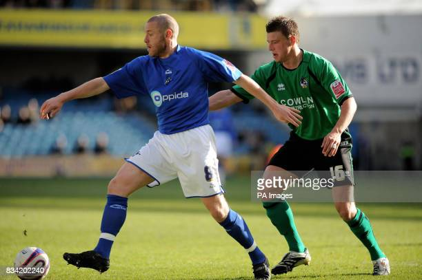 Millwall's Zak Whitebread and Bristol Rovers' Danny Coles battle for the ball during the CocaCola League One match at The Den London