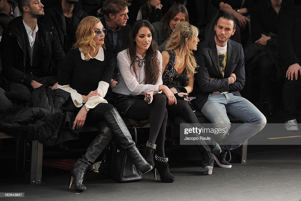 Milly Carlucci, Silvia Slitti (3L) and Giampaolo Pazzini attend the John Richmond fashion show as part of Milan Fashion Week Womenswear Fall/Winter 2013/14 on February 25, 2014 in Milan, Italy.
