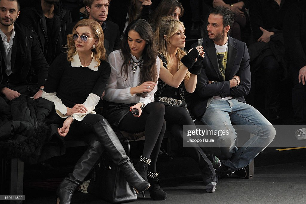 Milly Carlucci, Silvia Slitti (3R) and Giampaolo Pazzini attend the John Richmond fashion show as part of Milan Fashion Week Womenswear Fall/Winter 2013/14 on February 25, 2014 in Milan, Italy.
