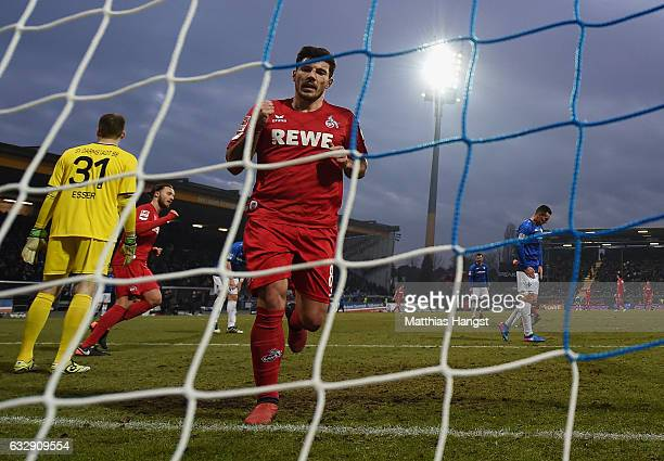 Milo Jojic of Koeln celebrates after scoring his team's fifth goal during the Bundesliga match between SV Darmstadt 98 and 1 FC Koeln at Stadion am...