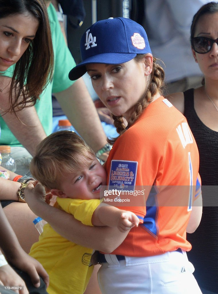 Milo Thomas Bugliari (L) and mother/actress <a gi-track='captionPersonalityLinkClicked' href=/galleries/search?phrase=Alyssa+Milano&family=editorial&specificpeople=203329 ng-click='$event.stopPropagation()'>Alyssa Milano</a> attend the Taco Bell All-Star Legends & Celebrity Softball Game at Citi Field on July 14, 2013 in New York City.