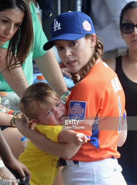 Milo Thomas Bugliari and mother/actress Alyssa Milano attend the Taco Bell AllStar Legends Celebrity Softball Game at Citi Field on July 14 2013 in...