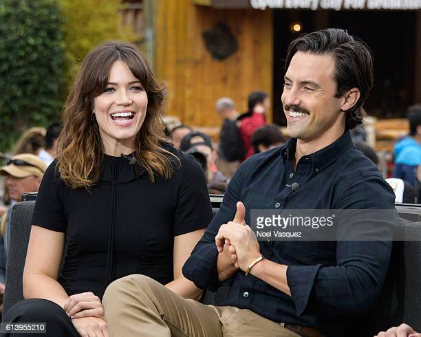 Milo Ventimiglia and Mandy Moore visit 'Extra' at Universal Studios Hollywood on October 11 2016 in Universal City California