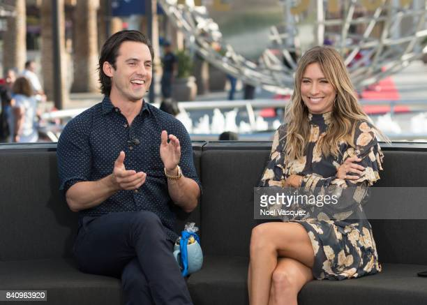 Milo Ventimiglia and Renee Bargh visit 'Extra' at Universal Studios Hollywood on August 30 2017 in Universal City California