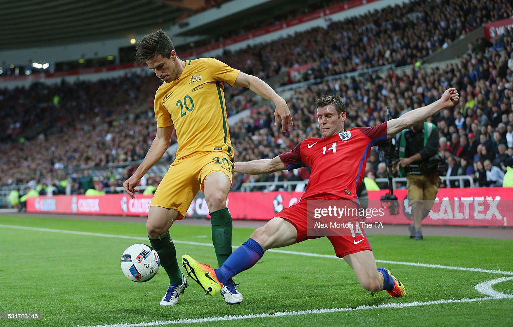 Milos Degenak of Australia and <a gi-track='captionPersonalityLinkClicked' href=/galleries/search?phrase=James+Milner&family=editorial&specificpeople=214576 ng-click='$event.stopPropagation()'>James Milner</a> of England during the International Friendly match between England and Australia at Stadium of Light on May 27, 2016 in Sunderland, England.