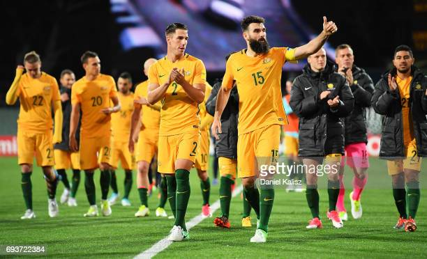 Milos Degenek and Mile Jedinak of Australia applaude the crowd after the 2018 FIFA World Cup Qualifier match between the Australian Socceroos and...