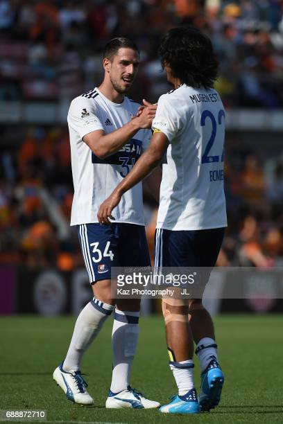 Milos Degenek and Yuji Nakazawa of Yokohama FMarinos celebrate their 31 victory in the JLeague J1 match between Shimizu SPulse and Yokohama FMarinos...