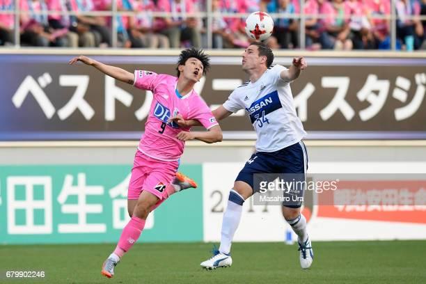Milos Degenek of Yokohama FMarinos and Cho Dong Geon of Sagan Tosu compete for the ball during the JLeague J1 match between Sagan Tosu and Yokohama...