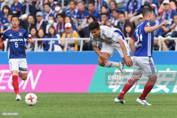 Milos Degenek of Yokohama FMarinos and Dudu of Ventforet Kofu compete for the ball during the JLeague J1 match between Yokohama FMarinos and...