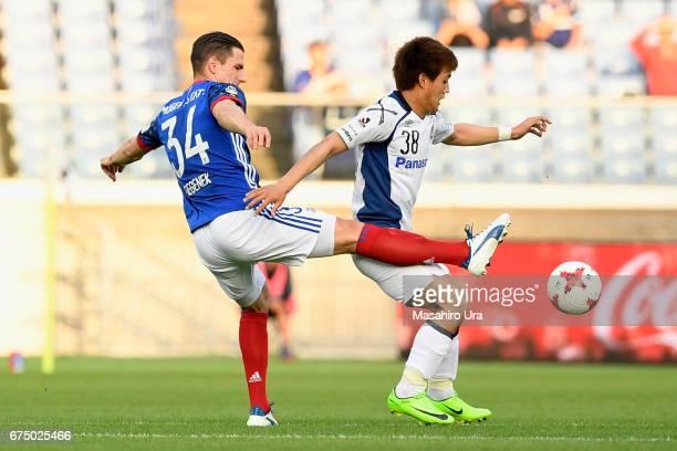 Milos Degenek of Yokohama FMarinos and Ritsu Doan of Gamba Osaka compete for the ball during the JLeague J1 match between Yokohama FMarinos and Gamba...