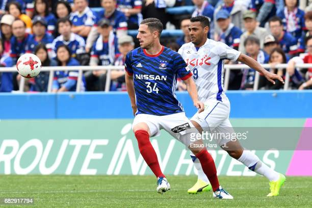 Milos Degenek of Yokohama FMarinos and Wilson of Ventforet Kofu compete for the ball during the JLeague J1 match between Yokohama FMarinos and...