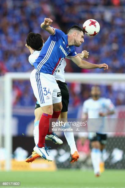 Milos Degenek of Yokohama FMarinos and Yu Kobayashi of Kawasaki Frontale compete for the ball during the JLeague J1 match between Yokohama FMarinos...