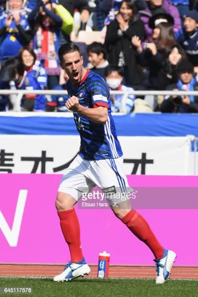 Milos Degenek of Yokohama FMarinos celebrates his team's first goal by David Babunski during the JLeague J1 match between Yokohama FMarinos and Urawa...