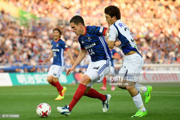 Milos Degenek of Yokohama FMarinos controls the ball under pressure of Ritsu Doan of Gamba Osaka during the JLeague J1 match between Yokohama...