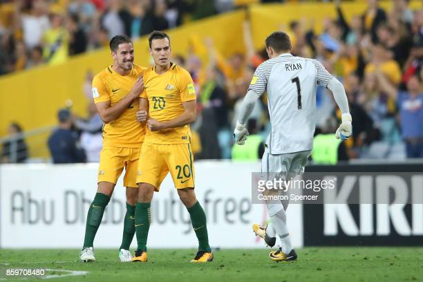 Milos Degenek Trent Sainsbury and Mathew Ryan of Australia celebrate winning the 2018 FIFA World Cup Asian Playoff match between the Australian...
