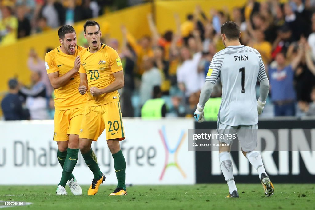 Milos Degenek, Trent Sainsbury and Mathew Ryan of Australia celebrate winning the 2018 FIFA World Cup Asian Playoff match between the Australian Socceroos and Syria at ANZ Stadium on October 10, 2017 in Sydney, Australia.
