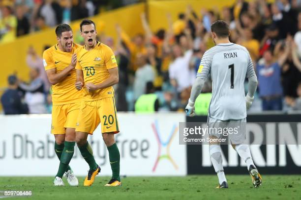 Milos Degenek Trent Sainsbury and Mathew Ryan of Australia celebrate winning the 2018 FIFA World Cup Asian Playoff match between the Australian...