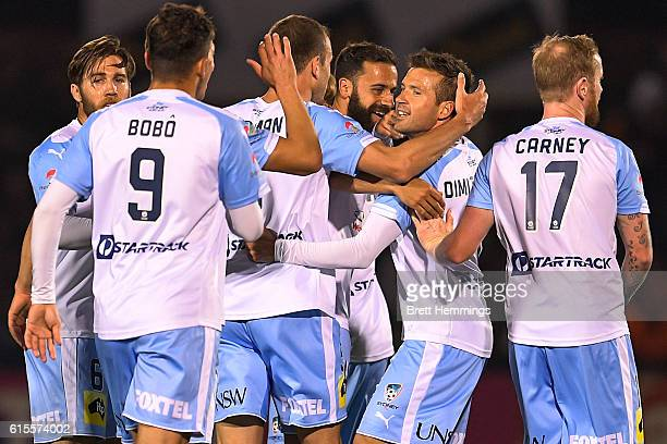 Milos Dimitrijevic of Sydney celebrates scoring a goal with team mates during the FFA Cup Semi Final match between Canberra Olympic and Sydney FC at...