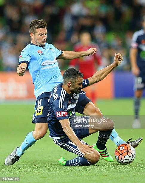 Milos Dimitrijevic of Sydney FC and Fahid Ben Khalfallah of the Victory compete for the ball during the round 21 ALeague match between Melbourne...