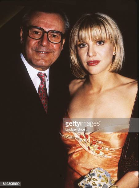 Milos Forman and Courtney Love pause for a photograph together as they arrive at ACLU Torch of Liberty Dinner at the Century Plaza Hotel Los Angeles...