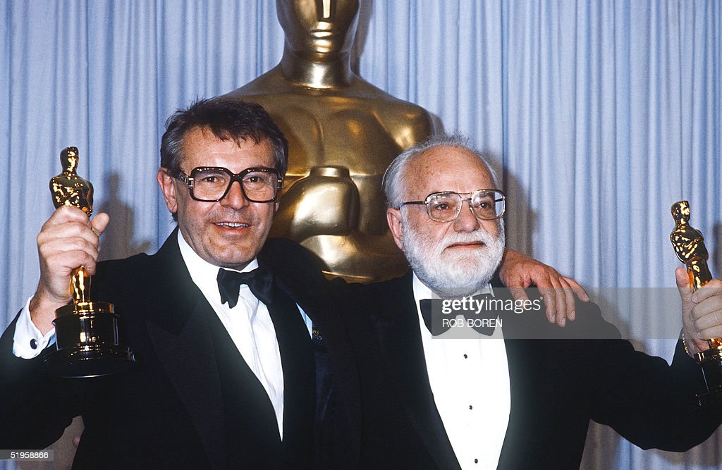 Milos Forman (L), Czechoslovakian-born US filmmaker and Saul Zaentz, respectively director and producer of 'Amadeus', a movie based on the life of Wolfgang Amadeus Mozart, hold their Oscars 25 March 1985 in Hollywood at the Annual Acacemy Awards in Hollywood. 'Amadeus' won a remarkable 11 Oscars, including Best Picture and Best Director. Born in 1932 in Caslav, a small town outside of Prague, Forman lost both his parents in the Nazi death camps during WWII. In the early 1950s, Forman enrolled at the newly founded Prague Film Institute (FAMU), where he worked with many of the major figures of the 'New Wave of Czech Cinema' of the 1960s. When Warsaw Pact tanks rumbled into Prague in August 1968, Forman emigrated to the US. Forman's second American movie, 'One Flew Over The Cuckoo's Nest', swept the Academy Awards, winning all five major Oscars.