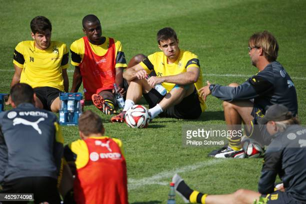 Milos Jojic Adrian Ramos and Sokratis Papastathopoulos listen to head coach Juergen Klopp during a training session in the Borussia Dortmund training...