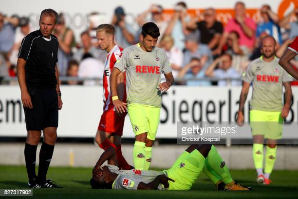 Milos Jojic care of Jhon Cordoba of Koeln after an injury during the preseason friendly match between TSV Steinbach and 1 FC Koeln at...