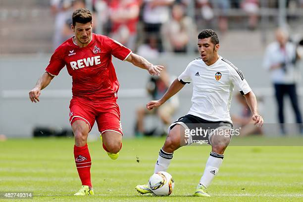 Milos Jojic of 1 FC Koln Zakaria Bakkali of Valencia CF during the Colonia Cup match between 1 FC Koln and Valencia on August 2 2015 at the...