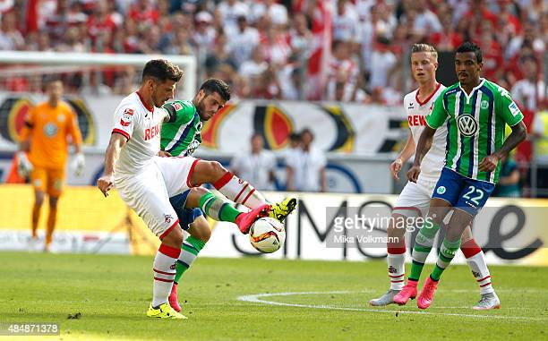 Milos Jojic of Cologne challenges Vieirinha of Wolfsburg during the Bundesliga match between 1 FC Koeln and VfL Wolfsburg at RheinEnergieStadion on...
