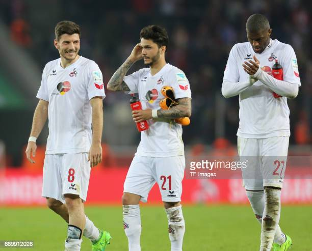 Milos Jojic of Cologne Leonardo Bittencourt and Anthony Modeste looks on during the German Bundesliga soccer match between 1 FC Cologne and Eintracht...