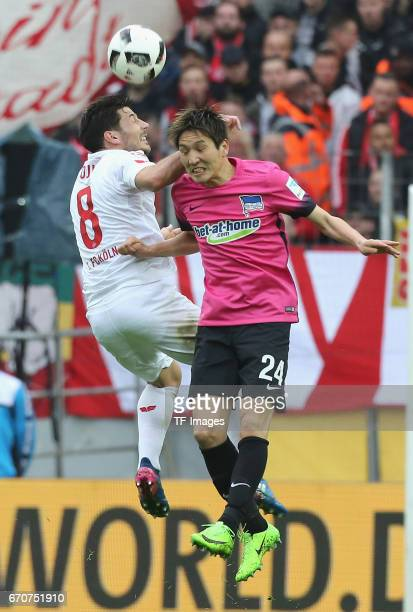 Milos Jojic of Colonge and Genki Haraguchi of Berlin battle for the ball during the Bundesliga match between 1 FC Koeln and Hertha BSC at...