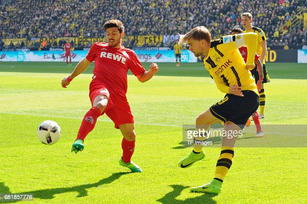 Milos Jojic of Colonge and Marcel Schmelzer of Dortmund battle for the ball during the Bundesliga match between Borussia Dortmund and FC Koeln at...