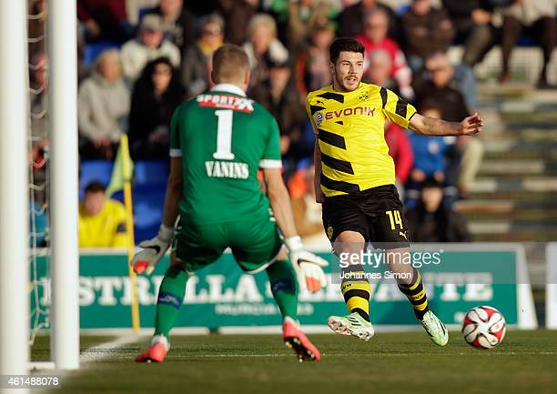 Milos Jojic of Dortmund tries to score against Andris Vanins goalkeeper of Sion during a friendly match between Borussia Dortmund and FC Sion during...