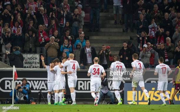 Milos Jojic of Koeln celebrates his teams first goal with his team mates during the Bundesliga match between 1 FC Koeln and Eintracht Frankfurt at...