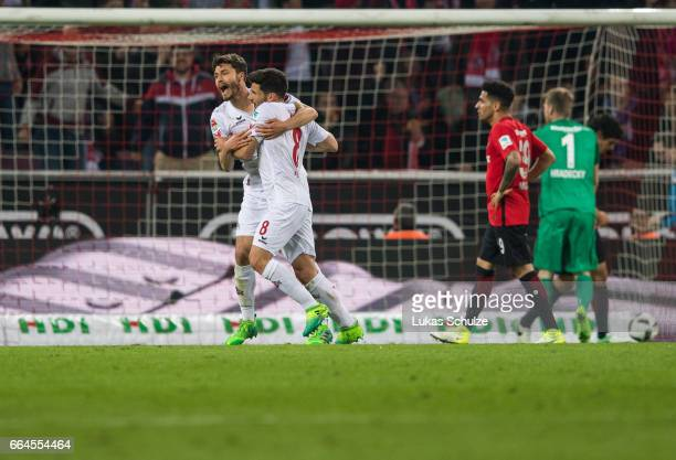 Milos Jojic of Koeln celebrates his teams first goal with Jonas Hector of Koeln during the Bundesliga match between 1 FC Koeln and Eintracht...