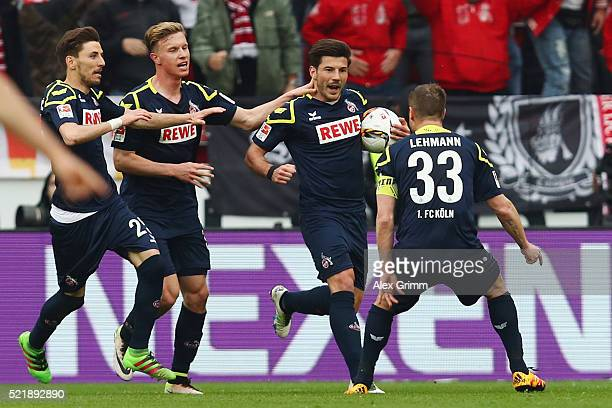 Milos Jojic of Koeln celebrates his team's second goal with team mates during the Bundesliga match between 1 FSV Mainz 05 and 1 FC Koeln at Coface...