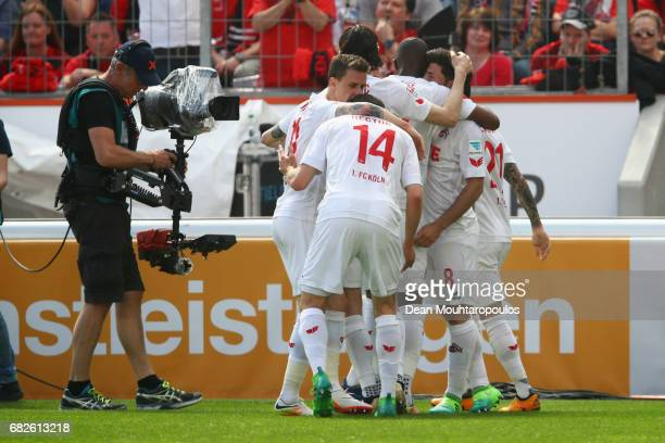 Milos Jojic of Koeln celebrates scoring his teams first goal of the game with team mates during the Bundesliga match between Bayer 04 Leverkusen and...