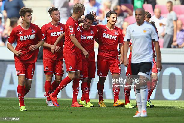 Milos Jojic of Koeln celebrates the third goal with Kevin Vogt and Philipp Hosiner of Koeln during the Colonia Cup 2015 match between 1 FC Koeln and...