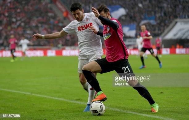 Milos Jojic of Koeln challenges Marvin Plattenhardt of Berlin during the Bundesliga match between 1 FC Koeln and Hertha BSC at RheinEnergieStadion on...