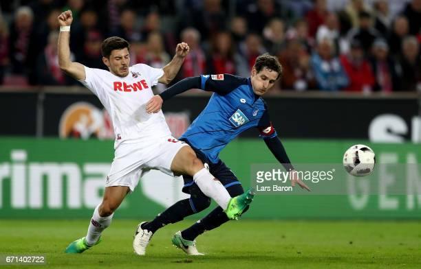 Milos Jojic of Koeln challenges Sebastian Rudy of Hoffenheim during the Bundesliga match between 1 FC Koeln and TSG 1899 Hoffenheim at...