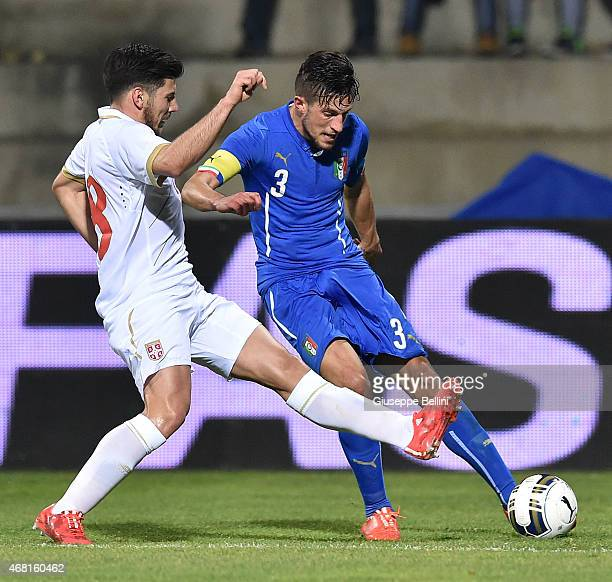 Milos Jojic of Serbia and Cristiano Biraghi of Italy in action during the international friendly match between Italy U21 and Serbia U21 at Stadio...