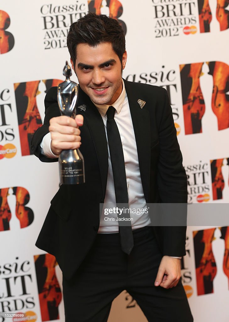 Milos Karadaglic poses with his Breakthrough Artist trophy as he attends the Classic BRIT Awards at the Royal Albert Hall on October 2, 2012 in London, England.