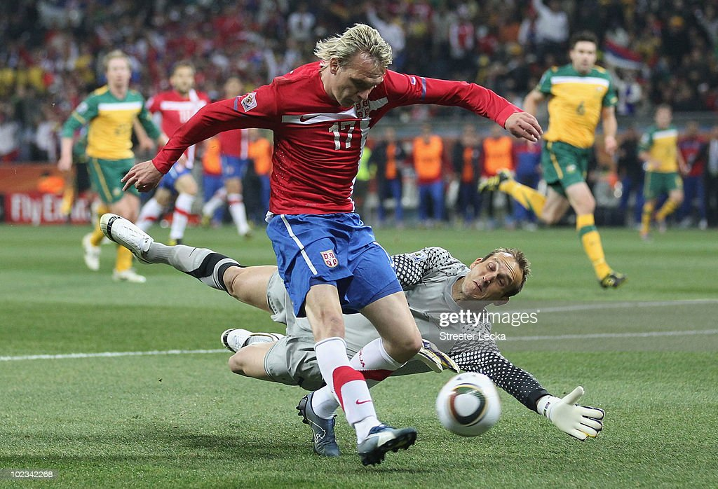 <a gi-track='captionPersonalityLinkClicked' href=/galleries/search?phrase=Milos+Krasic&family=editorial&specificpeople=757121 ng-click='$event.stopPropagation()'>Milos Krasic</a> of Serbia attempts to round <a gi-track='captionPersonalityLinkClicked' href=/galleries/search?phrase=Mark+Schwarzer&family=editorial&specificpeople=208085 ng-click='$event.stopPropagation()'>Mark Schwarzer</a> of Australia during the 2010 FIFA World Cup South Africa Group D match between Australia and Serbia at Mbombela Stadium on June 23, 2010 in Nelspruit, South Africa.