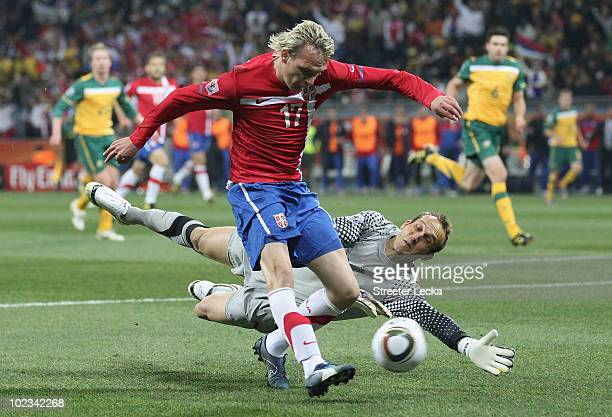 Milos Krasic of Serbia attempts to round Mark Schwarzer of Australia during the 2010 FIFA World Cup South Africa Group D match between Australia and...