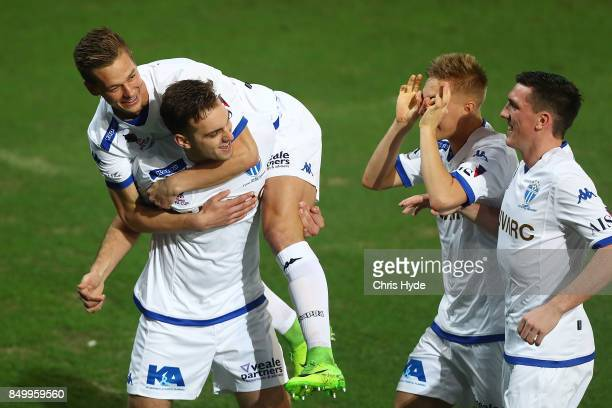 Milos Lujic of South Melbourne celebrates with team mates after scoring during the FFA Cup Quarter Final match between Gold Coast City FC and South...