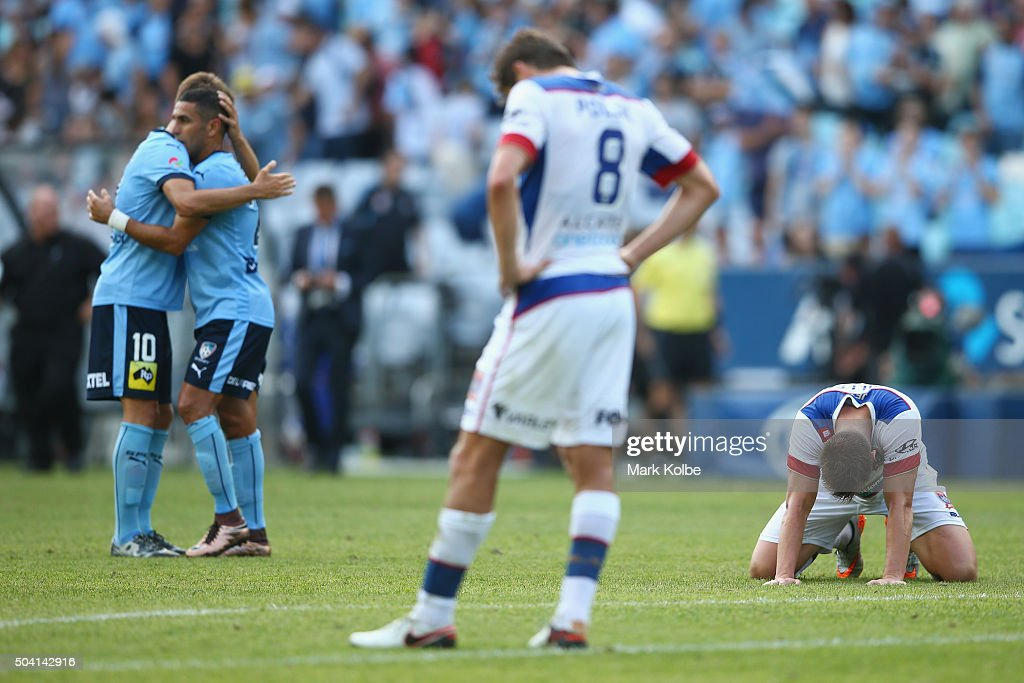 <a gi-track='captionPersonalityLinkClicked' href=/galleries/search?phrase=Milos+Ninkovic&family=editorial&specificpeople=4695877 ng-click='$event.stopPropagation()'>Milos Ninkovic</a> and Ali Abbas of Sydney FC celebrate victory as Mateo Poljak and Daniel Mullen of the Jets look dejected during the round 14 A-League match between Sydney FC and the Newcastle Jets at ANZ Stadium on January 9, 2016 in Sydney, Australia.