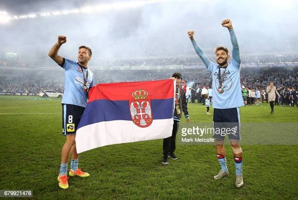 Milos Ninkovic and Milos Dimitrijevic of Sydney FC celebrate winning the 2017 ALeague Grand Final match between Sydney FC and the Melbourne Victory...